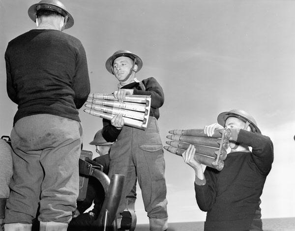 Gunners passing ammunition for a Bofors 40mm. anti-aircraft gun.