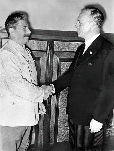 Stalin and Ribbentrop shaking hands after the signing of the pact in the Kremlin