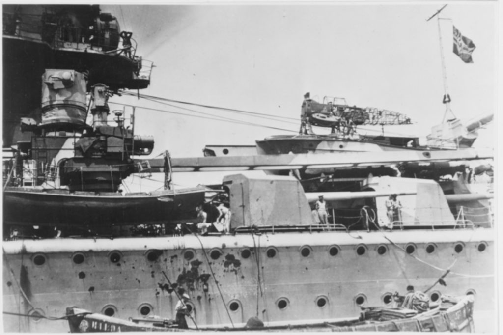 Admiral Graf Spee after the Battle of the River Plate. Showing a burned out seaplane and shell damage.