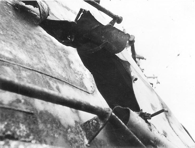 Admiral Graf Spee after the Battle of the River Plate. Showing a massive hole, likely result of a direct shell strike.